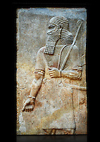 Stone relief sculptured panel of Soldier. Room 8. Inv AO 19877 from Dur Sharrukin the palace of Assyrian king Sargon II at Khorsabad, 713-706 BC.  Louvre Museum Room 4 , Paris
