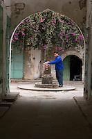 Derna, Libya - Filling Water Bottle at Public Fountain