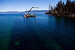 The barge work station in Emerald Bay on the edge of where divers are placing mats on the lake floor to control Asian clams, an invasive species to Lake Tahoe at Camp Richardson, Calif., October 30, 2012.