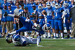 Wide receiver Demarco Robinson (9) dodges over defensive back Chris Davis (30) during the Blue/White Spring Game in Lexington, Ky., on Saturday, April 26, 2014. Blue defeated White 38-14. Photo by Adam Pennavaria | Staff