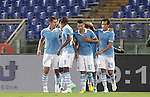 Calcio, Serie A: Lazio vs Palermo. Roma, stadio Olimpico, 2 settembre 2012..Lazio forward Miroslav Klose, of Germany, left, celebrates with teammates after scoring during the Italian Serie A football match between Lazio and Palermo at Rome's Olympic stadium, 2 September 2012..UPDATE IMAGES PRESS/Riccardo De Luca