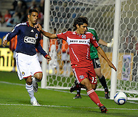 Chicago defender Deris Umanzor (13) clears the ball in front of Chivas defender Michael Umana (4).  The Chicago Fire tied Chivas USA 1-1 at Toyota Park in Bridgeview, IL on May 1, 2010.