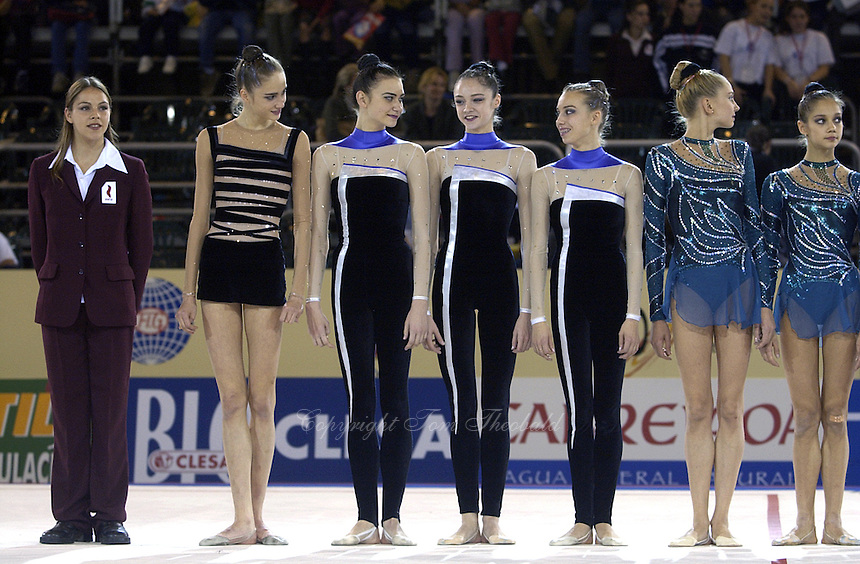 October 19, 2001; Madrid, Spain:  (L-R) Olena Dzyubchuk, Tamara Yerofeeva, Anna Bessonova, Natalia Godunko are team Ukraine...also (to right) Olga Belova, Irina Tchachina of team Russia. About to receive team medals at 2001 World Championships at Madrid.