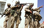 Following the detonation of an IED and an exchange of small arms fire, the Marines of H&S and India Companies 3rd Battalion 1st Marines (3/1) surround and search a gas station on the outskirts of the al-Anbar Province city of Hit, Iraq on Sun. Sept. 18, 2005. A trio of men surrendered themselves after exiting the station under a white flag and were detained for questioning. The subsequent search of the gas station uncovered no insurgents or weapons.