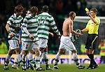 Celtic v St Johnstone....26.12.10  .Cha Du Ri gets his shirt back from ref Calum Murray and gets a yellow card.Picture by Graeme Hart..Copyright Perthshire Picture Agency.Tel: 01738 623350  Mobile: 07990 594431