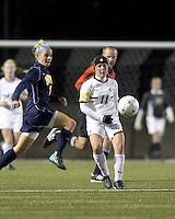 "Boston College defender Hannah Cerrone (11) passes the ball as West Virginia forward Megan Mischler (7) defends. Boston College defeated West Virginia, 4-0, in NCAA tournament ""Sweet 16"" match at Newton Soccer Field, Newton, MA."