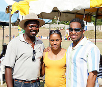 A fan stops for a photo op with Torri Edwards and Ato Bolden at the Douglas Forrest Track Meet held at Stadium East  Kingston, Jamaica on Saturday, January 12, 2008. Photo by Errol Anderson,The Sporting Image..