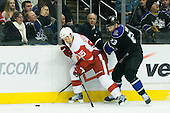 Dustin Brown (Los Angeles Kings, #23) vs Niklas Kronwall (Detroit Red Wings, #55) during ice-hockey match between Los Angeles Kings and Detroit Red Wings in NHL league, February 28, 2011 at Staples Center, Los Angeles, USA. (Photo By Matic Klansek Velej / Sportida.com)