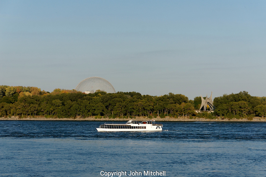 Le Bateauu Bouche cruise boat on the St. Lawrence River with St. Helen's Island in back, Montreal, Quebec, Canada