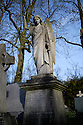 London, UK. 11.01.2015. Carved angels on graves, Highgate East Cemetery. Photograph © Jane Hobson.