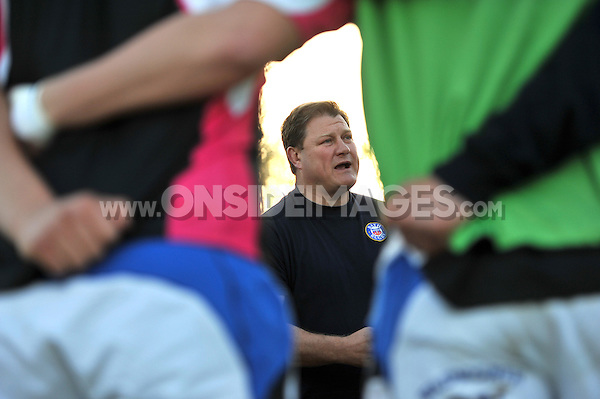 Forwards coach Neal Hatley speaks to his players during the pre-match warm-up. End-of-season friendly match, between Bath United and Somerset County Senior XV on April 14, 2014 at the Recreation Ground in Bath, England. Photo by: Patrick Khachfe / Onside Images