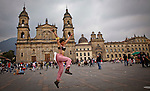 A woman jumps in the bolivar square while people take part in a march supporting prostitution in Bogota, Colombia. 25/02/2012.  Photo by Eduardo Munoz Alvarez / VIEWpress.