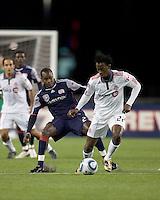 Toronto FC midfielder Amadou Sanyang (22) dribbles as New England Revolution midfielder Joseph Niouky (23) defends. The New England Revolution defeated Toronto FC, 4-1, at Gillette Stadium on April 10, 2010.