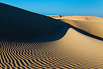 Desert sand dunes at the Lagoon of Khenifiss (Lac Naila), Atlantic coast, Morocco.