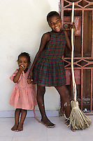 Young girls at an orphanage supported by EDV, Port-au-Prince, Haiti. EDV is committed to affecting permanent change in disaster-affected communities worldwide. Their role is to facilitate personal connections between volunteers and the survivors of disasters.  The charity is based on a proven model developed by several landmark organisations that have paved the way for citizens to become disaster volunteers. These landmark organisations have shown that supposedly ordinary people working together with the guidance of knowledgeable leaders can make an extraordinary difference in the lives of those affected by disaster..EDV believe that to provide meaningful relief and reconstruction assistance to disaster affected communities they have to do more than reconstruct buildings. They need to understand and address the factors that made a community vulnerable to the disaster in the first place. The charity's work is organised with these factors in mind so that they can affect change that far outlives their presence..EDV believes that survivor motivation is essential to the recovery of any disaster-affected community. Their operations will always be predicated on the idea that survivors may be traumatised, but they are not helpless. With this in mind, EDV encourages host communities to direct their own recovery. EDV believe that this empowerment is essential in helping survivors feel a renewed sense of control over their lives which will, in turn, help overcome the feelings of hopelessness that can follow a disaster and inhibit long term recovery. EDV also believe that social cohesion is of primary importance in any disaster-affected area. No amount of bricks or mortar will bring about sustainable improvement if communities fail to come together or are disrupted by relief efforts. Therefore, their operations will always aim to foster communication and cooperation within and between the communities they serve.