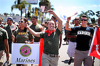 Marine Jaime Rincon,M marches down University Avenue, with other military personel, during the San Diego Gay Pride Parade  in San Diego, California .  Hundreds of active duty military personel -gay and straight, participated for the first time in the march as the governments official &quot;Don't ask Don't Tell&quot; policy slowly comes to an end.