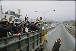 The Ayatollah Khomeini supporters en route towards Shahyad Square from the outskirts of the capital. Tehran, January 26, 1979.
