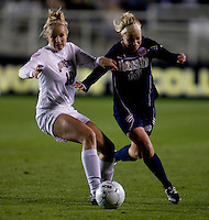 Paige Maxwell (10) of Ohio State and Kecia Morway (16) of Notre dame fight for the ball during the first game of the NCAA Women's College Cup at WakeMed Soccer Park in Cary, NC.  Notre Dame defeated Ohio State, 1-0.