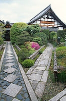 Two pathways converge at a shrine and illustrate the creative use that Japanese style makes of stones.