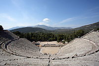 EPIDAURUS, GREECE - APRIL 14 : A view from above of the Theatre, on April 14, 2007 in Epidaurus, Greece. The Theatre, designed by Polykleitos the Younger, was built in the late 4th century BC and extended in the Hellenistic period. It was rediscovered in 1881 and significantly restored in the 1950s.  It has the three main features of a Greek theatre: the orchestra, a sunken round stage; the skene, a raised rectangular stage; and the cavea, a raked semi-circular auditorium with radiating diazomas. The theatre is renowned for its accoustics thanks to the symmetry of the cavea, and for its beautiful mountain view, seen here in the afternoon light. (Photo by Manuel Cohen)