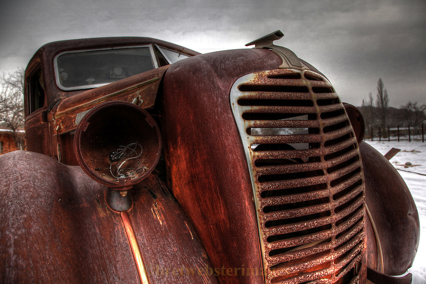 A special old rusty truck begs for a rub on his snout.
