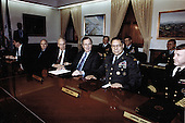 On January 18, 1991, United States President George H.W. Bush with his staff of civilian and military leaders, gathered in the &quot;tank&quot;, the conference room of the Joint Chiefs of Staff in the Pentagon, for briefings and discussions concerning Operation Desert Storm.  From left to right: John H. Sununu, White House Chief of Staff; Brent Scowcroft, Assistant to the President for National Security Affairs; Honorable Dick Cheney, Secretary of Defense; President Bush; General Colin L. Powell, Chairman, Joint Chiefs of Staff; and Admiral David E. Jeremiah, Vice Chairman, Joint Chiefs of Staff.<br /> Mandatory Credit: Helene Stikkel / DoD via CNP