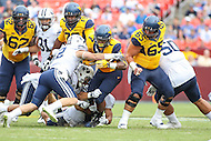 Landover, MD - September 23, 2016: West Virginia Mountaineers running back Rushel Shell (7) gets tackled by BYU Cougars defensive back Kai Nacua (12) during game between BYU and WVA at  FedEx Field in Landover, MD.  (Photo by Elliott Brown/Media Images International)