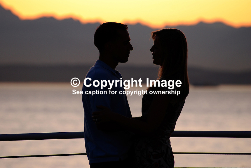 Couple, boy, girl, romance, romantic moment, cruise ship, cruise, Seattle, Washington State, USA, sunset, evening, twilight, lovers, 200809141472..Copyright Image from Victor Patterson, 54 Dorchester Park, Belfast, UK, BT9 6RJ..Tel: +44 28 9066 1296.Mob: +44 7802 353836.Voicemail +44 20 8816 7153.Skype: victorpattersonbelfast.Email: victorpatterson@mac.com.Email: victorpatterson@ireland.com (back-up)..IMPORTANT: If you wish to use this image or any other of my images please go to www.victorpatterson.com and click on the Terms & Conditions. Then contact me by email or phone with the reference number(s) of the image(s) concerned.