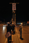 SULAIMANIYAH, IRAQ:  Election workers hang a party sign the night before the first day of the official election campaigning...Election workers start their campaigns for the Iraqi Parliamentary Elections due to be held March 7th, 2010...Photo by Aram Karim/Metrography