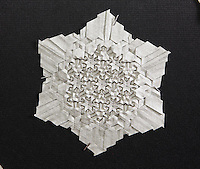 Origami tessellation designed and folded by Benjamin Parker, Connecticut, USA. This one from a series of tessellations entitled Etched in Stone and folded from Elephant Hide paper.