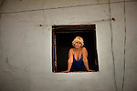 portrait of cuban woman in window