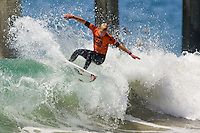 Aussie Mick Fanning with a lip smack during round of 96 of the 2010 US Open of Surfing in Huntington Beach, California on August 4, 2010.