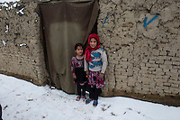 Children in an unnamed refugee camp in district 5 of Kabul at the onset of winter 8-1-14