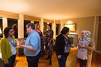 SEATTLE, WA-APRIL 17, 2017:  Charissa Pomrehn, left, speaks with Nason Fox, Stefanie Fox speaks with Patricia Rangel, and Anjana Agarwal speaks with Amanda Saab, far right, as the dinner party guest prepare to leave. Amanda Saab, along with her husband Hussein Saab, co-hosted a &quot;dinner with your Muslim neighbor&quot; at the home of Stefanie and Nason (cq) Fox in Seattle, WA on a return trip April 17th 2017. The couple now live in Detroit. <br /> <br /> (Photo by Meryl Schenker/For The Washington Post)