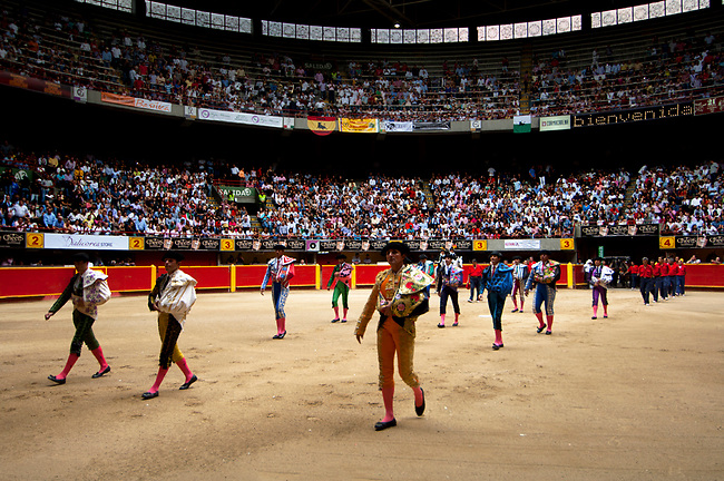 The matadors enter the bullfighting ring at La Macarena Stadium.  The Festival of the Bulls is a month long celebration of bullfighting.  Colombia is one of the few Latin American countries where the original form of bullfighting is still practiced.