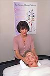 therapist aligning chakra during Reiki massage