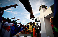 HAITI, Croix du Buquet, November 3, 2008..Believers attend Voodoo ceremonies in Croix du Buquet, November 3, 2008. VIEWpress / Kena Betancur..The principal belief in Haitian Vodou is that deities called Lwa (or Loa) are subordinates to a god called Bondyè. This supreme being does not intercede in human affairs, and it is to the Lwa that Vodou worship is directed. Other characteristics of Vodou include veneration of the dead and protection against evil.