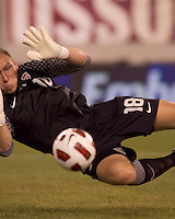 USA goalkeeper Brad Guzan (18) saves a close-in shot. Brazil  defeated the US men's national team, 2-0, in a friendly at Meadowlands Stadium on August 10, 2010.