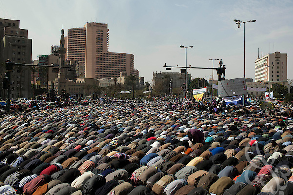 "Thousands of Egyptian anti-Mubarak protesters pray together during a large demonstration dubbed the ""Day of Departure"" February 04, 2011 in Tahrir Square in Cairo, Egypt. Protesters hoped today's protests might finally push the Mubarak regime to full collapse, however despite the large turnout, there appeared to be little political resolution. .."