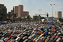 """Thousands of Egyptian anti-Mubarak protesters pray together during a large demonstration dubbed the """"Day of Departure"""" February 04, 2011 in Tahrir Square in Cairo, Egypt. Protesters hoped today's protests might finally push the Mubarak regime to full collapse, however despite the large turnout, there appeared to be little political resolution. .."""