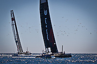 PORTUGAL, Cascais. 7th August 2011. America's Cup World Series. Day 2. CHINA TEAM follow ORACLE Racing Spithill to the finish.