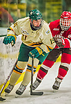 14 December 2013: University of Vermont Catamount Defenseman Yvan Pattyn, a Sophomore from St. Anne, Manitoba, is shadowed by Saint Lawrence University Saint Forward Chris Martin, a Junior from Ottawa, Ontario, in the third period at Gutterson Fieldhouse in Burlington, Vermont. The Catamounts defeated their former ECAC rivals, 5-1 to notch their 5th straight win in NCAA non-divisional play. Mandatory Credit: Ed Wolfstein Photo *** RAW (NEF) Image File Available ***