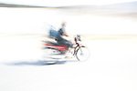 A motorcycle passes by on Tuesday, Apr. 7, 2009 in Ventanilla, Peru.