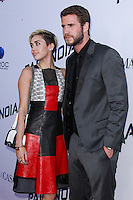 """[(FILE) Miley Cyrus and Liam Hemsworth call off engagement - announced Monday, September 16, 2013.] LOS ANGELES, CA - AUGUST 08: Miley Cyrus and Liam Hemsworth arrive at the """"Paranoia"""" Los Angeles Premiere held at DGA Theater on August 8, 2013 in Los Angeles, California. (Photo by Xavier Collin/Celebrity Monitor)"""