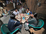 A family sits down for dinner in their home in Santa Elena, in Guatemala's Peten region.