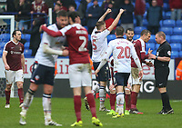 Bolton Wanderers' Mark Beevers holds his arms in the air after the final whistle <br /> <br /> Photographer Alex Dodd/CameraSport<br /> <br /> The EFL Sky Bet League One - Bolton Wanderers v Northampton Town - Saturday 18th March 2017 - Macron Stadium - Bolton<br /> <br /> World Copyright &copy; 2017 CameraSport. All rights reserved. 43 Linden Ave. Countesthorpe. Leicester. England. LE8 5PG - Tel: +44 (0) 116 277 4147 - admin@camerasport.com - www.camerasport.com
