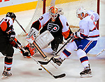 15 November 2008:  Philadelphia Flyers' goaltender Martin Biron makes a save on Montreal Canadiens' center and Team Captain Saku Koivu from Finland in the second period during their first meeting in Montreal since the Flyers knocked the Canadiens out of the playoffs last season. The Canadiens, celebrating their 100th season, fell to the visiting Flyers 2-1 at the Bell Centre in Montreal, Quebec, Canada. ***Editorial Sales Only***..Mandatory Photo Credit: Ed Wolfstein Photo *** Editorial Sales through Icon Sports Media *** www.iconsportsmedia.com
