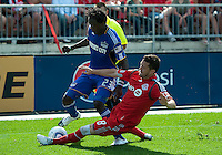 05 June 2010: Kansas City Wizards forward Kei Kamara #23 battles with Toronto FC defender Dan Gargan #8 during a game between the Kansas City Wizards and Toronto FC at BMO Field in Toronto..The game ended in a 0-0 draw.