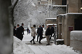 Chicago, IL - December 19, 2008 -- United States President-elect Barack Obama and his wife Michelle enter the University of Chicago Laboratory Schools where their daughters attend school Friday morning, December 19, 2008.  .Credit: Anne Ryan - Pool via CNP