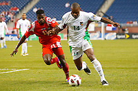 7 June 2011: Panama midfielder Armando Cooper (11) and Guadeloupe midfileder Gregory Gendrey (14) go for the ball during the CONCACAF soccer match between Panama and Guadeloupe at Ford Field Detroit, Michigan.